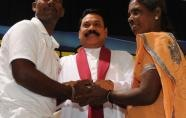 President of Sri Lanka Mahinda Rajapakse (C) reunites a Tamil mother with her ex-Tamil Tiger son (AFP, Lakruwan Wanniarachchi)