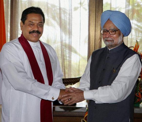 PTI Prime Minister Manmohan Singh greets Sri Lankan President Mahinda Rajapaksa on the sidelines of the SAARC Summit at Addu in Maldives. Photo: Subhash Chander Malhotra