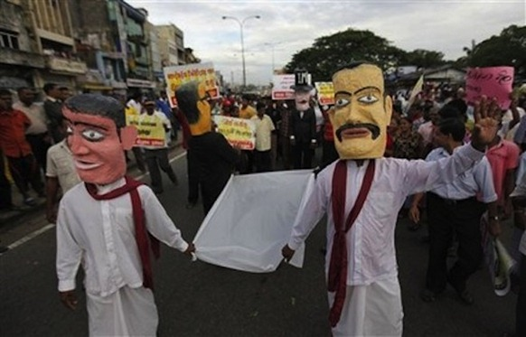 Photo courtesy Daylife. Activists of Sri Lanka's opposition Marxist People's Liberation Front, wearing masks that represent President Mahinda Rajapaksa and his brothers, walk in a protest against the government in Colombo, Sri Lanka, Wednesday, Dec. 2011