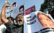 A Sri Lankan media rights activist holds a poster of journalist Lasantha Wickrematunge (AFP, Ishara S.Kodikara)