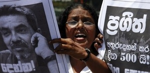 "A member of the Free Media Association shouts slogans in front of an image of missing cartoonist and columnist Prageeth Eknaligoda during a protest in Colombo June 8, 2011. The protest was held to mark 500 days since the disappearance of Eknaligoda, a pro-opposition journalist who worked for Lanka-e-News, a private-owned independent website that was critical of the government. The placard reads ""500 days since Prageeth's disappearance."""