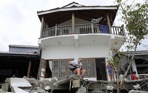 Tourists at one of dozens of guesthouses bulldozed in Unawatuna Photo: AFP