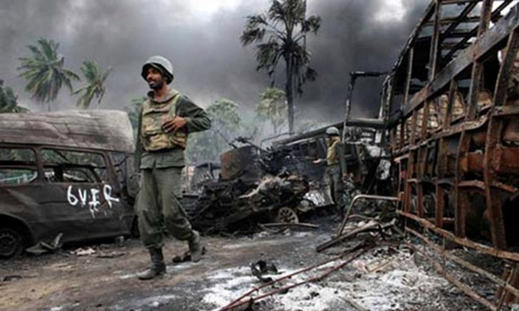 Sri Lankan soldiers inside the war zone in the north of the country at the end of the civil war in May 2009. Photograph: AFP Getty Images