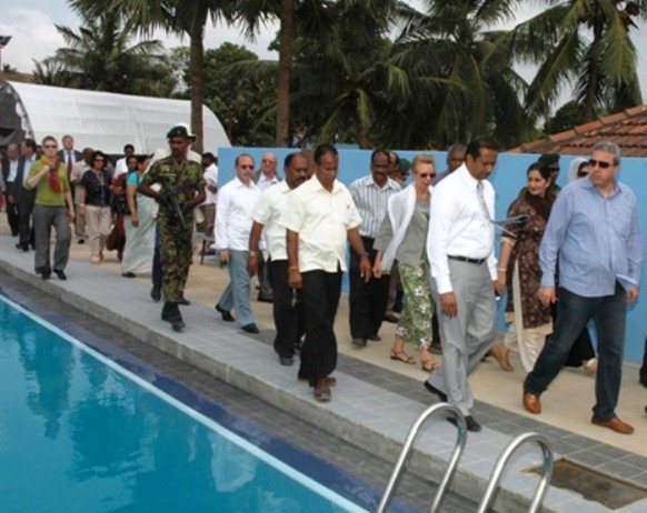 Indian-orchestrated delegates visiting a 'development' site - a swimming pool constructed in a leading school in Jaffna by diverting funds allocated to schools in war-torn Vanni.