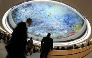 Delegates are seen during a special session of the UN Human Rights Council in Geneva (AFP/File, Fabrice Coffrini)