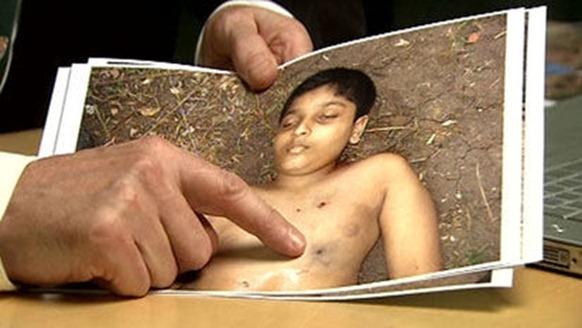BG DerrickPounder examinies an Image of the Body Balakandran Prabakharan a 12 year old boy
