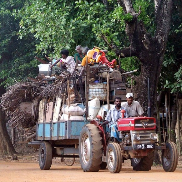 Red_tractor_huge_load._Jan_2009_displacement_in_the_Vanni Image from Wikimedia Commons