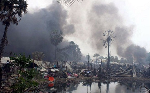 Sri Lanka's Killing Fields: smoke billows from a civilian no-fire zone shelled in 2009. Photo: EPA