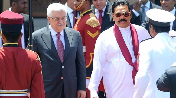 Palestinian President Mahmoud Abbas (2L) walks with Sri Lankan President Mahinda Rajapakse (3R) upon his arrival in Colombo on April 16, 2012. The Palestinian leader arrived on a two-day visit to the island. AFP PHOTO