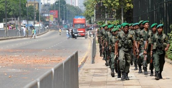 Sri Lanka's president says troops are in various areas, not just the north (AFP/File, Ishara S.Kodikara)