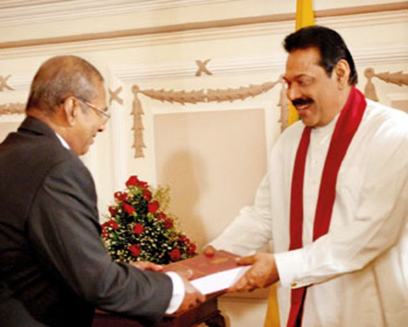LLRC Chairman C.R. de Silva presenting the LLRC report to President Rajapaksa in December last year