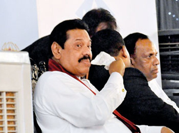 President Mahinda Rajapaksa feeling the heat at Expo 2012 held at the BMICH. Pic by Susantha Liyanawatte