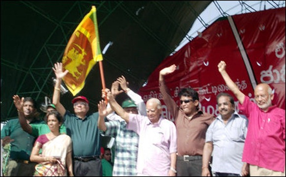 The sequence of UNP, TNA leaders waving to the crowd and the appearance of the Lion flag [Photos: TamilNet]
