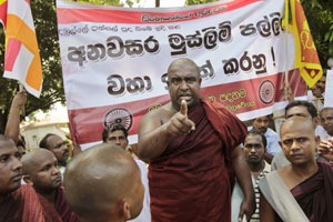 A Sri Lankan Buddhist monk gestures as he speaks to a gathering during a protest in Kalutara, south of Colombo. (AP)