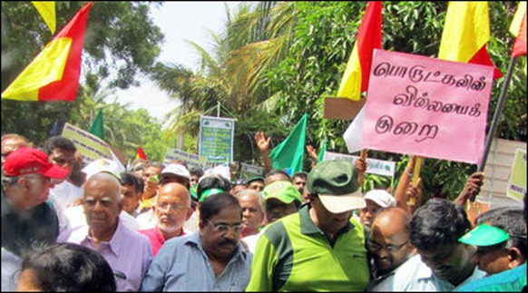 Sampanthan and Suresh walk under a placard in flawed Tamil brought by the UNP supporting southerners
