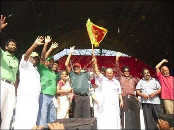The photo of Sampanthan and Ranil holding the Lion flag highlighted in the Colombo media [Photo courtesy: Daily Mirror]