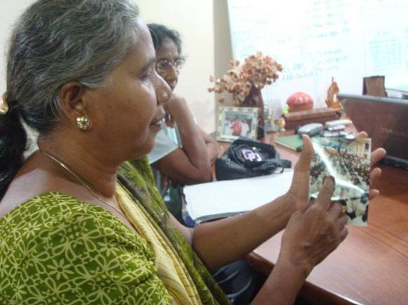 The Hindu Saroja Devi from Uppumaveli, Mullativu, pointing out her son Leon Roxy from a picture taken by me (The Hindu's correspondent in Sri Lanka) in September 2011 on Tuesday in Colombo. Photo : R.K. Radhakrishnan