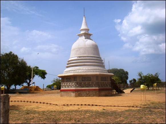 The Sinhala-Buddhist stupa at Vadduvaakal at the entrance to the strip of Mu'l'livaaykkaal. While the Tamil public was not allowed to enter the region, the stupa was secretely built and inaugurated recently.