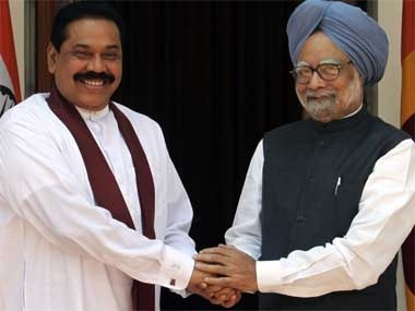 Rajapkse with Indian PM Manmohan Singh. Reuters