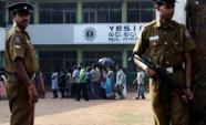 Policemen stand guard over a group of ethnic Sri Lankan Tamil residents from the northern Jaffna peninsula (AFP/File, Ishara S. Kodikara)