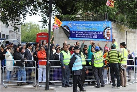 Sinhalese supporting Rajapaksa carrying Sri Lankan Lion flags outside Park Lane Hilton Hotel