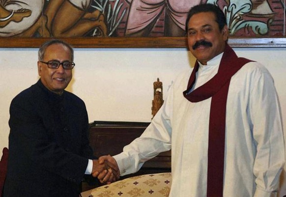 AP Sri Lankan President Mahinda Rajapaksa shakes hands with Pranab Mukherjee. File photo.