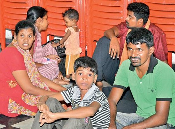 Sri Lankan Tamil refugees held by 'Q' branch police who thwarted their attempt to go by boat to Australia Thursday night. The 61 detained persons includes one Indian. The rest came from different refugee camps in the state. They are housed at a marriage hall in Kancheepuram. - DC