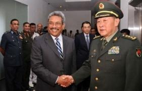 Chinese Defence Minister Liang Guanglie (R) shakes hands with Sri Lankan Defence Secretary Gotabhaya Rajapakse (AFP/Army Media)