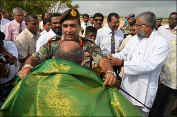 Jaffna commander of the occupying genocidal military, trailed behind by the SL minister and paramilitary leader Douglas Devananda, receives parliamentarians of the Commonwealth that once faught against the apartheid of South Africa. [Photo courtesy: Sri Lanka Army in Jaffna]