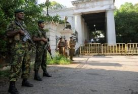 Sri Lankan Special Task Force (STF) soldiers stand guard outside the Colombo High Court in Colombo in 2011 (AFP/File, Ishara S.Kodikara)