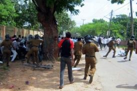 Sri Lankan police officials clash with university students in Jaffna (AFP)