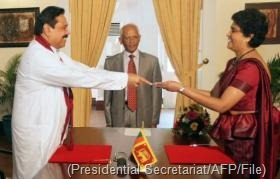 President Mahinda Rajapakse (L) presents a letter of appointment to Shirani Bandaranakaye in May 2011 (Presidential Secretariat/AFP/File)