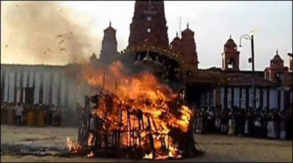 The Kaarthikai flame, called Chokkap-panai in Eezham Tamil, lighted in front of the Nalloor temple in 2011. It is called Chokkap-panai because of the use of dried palmyra palm leaves in making the flame.
