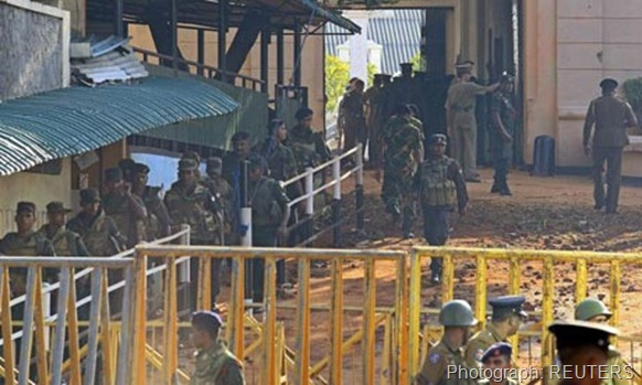 Army soldiers leave Welikada prison after clash between the Special Task Force and prisoners in Colombo Photograph: REUTERS