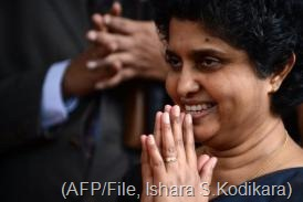 Sri Lanka?s Chief Justice Shirani Bandaranayake gestures as she exits The Supreme Court in Colombo, December 4, 2012 (AFP/File, Ishara S.Kodikara)