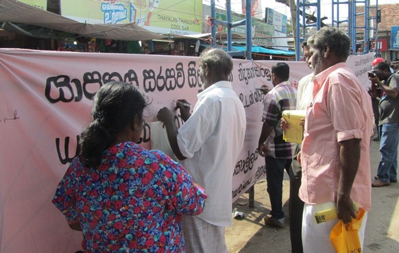The FLSP banner for signature campaign in Jaffna city on Tuesday