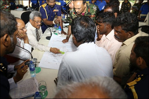 Gotabhaya explains his plans for 'state of the art' village adjacent to SL military base to the uprooted Tamil villagers [Photo courtesy: SL Defence website]
