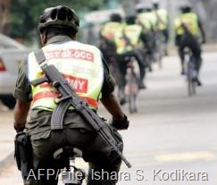 Sri Lankan security force personnel patrol on bicycles in Colombo on January 26, 2009 (AFP/File, Ishara S. Kodikara)