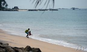 ALeqM5ioKx-The beach at Peraliya village in southern Sri Lanka on December 26, 2012 (AFP, Lakruwan Wanniarachchi)