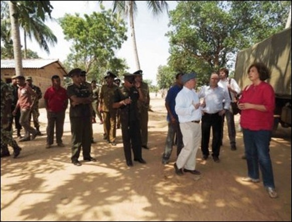 The UK Under Secretary and his team in the company of the Sinhala military and military intelligence at Keappaa-pulavu