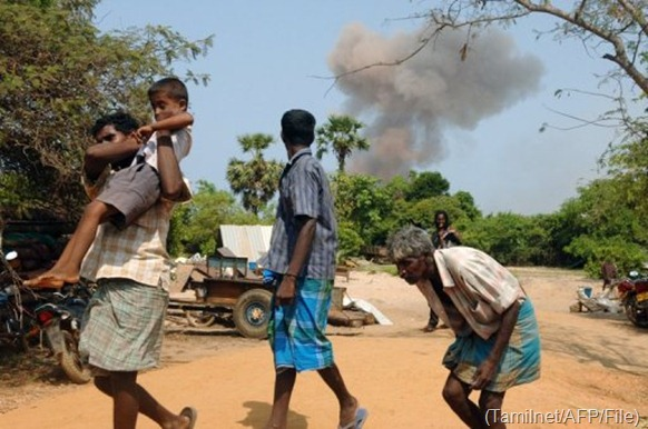 Civilians take cover after what they say is a gov't airstrike in Mullaitivu district, on April 25, 2009 (Tamilnet/AFP/File)