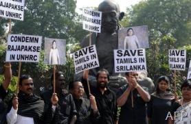 Dravida Munnetra Kazhagam members protest in New Delhi against the killing of Tamils in Sri Lanka, March 5, 2013 (AFP/File, Prakash Singh)