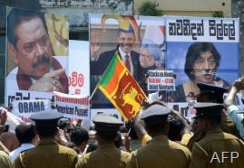 Police keep watch as Sri Lankan pro-government activists protest outside the US embassy in Colombo, on March 21, 2013 (AFP, Lakruwan Wanniarachchi)