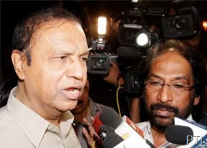 DMK leader T R Baalu (L) talks to media outside Rashtrapati Bhavan in New Delhi on Tuesday night after submitting a letter to President Pranab Mukherjee to withdraw the support to the UPA government. (PTI Photo)