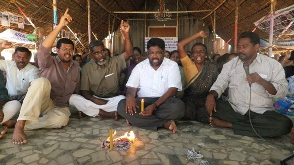 Activists at Idinthakarai burning the copies of the draft proposal tabled by the USA at the UNHRC at a recent protest