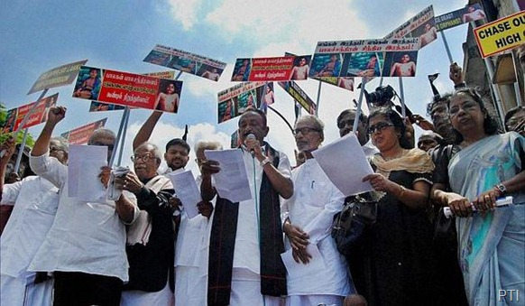 PTI MDMK Chief Vaiko with members of various political parties during a protest against Sri Lankan President Mahinda Rajapaksa at Madras High Court premises in Chennai on Monday.