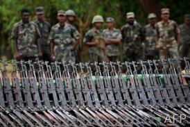 Image taken on April 24, 2009 shows army soldiers standing next to weapons captured from the Tamil Tigers in Sri Lanka (AFP/File, Pedro Ugarte)