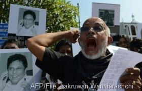 Sri Lankans demonstrate in Colombo on January 29, 2013, demanding investigation in to the killing of journalists (AFP/File, Lakruwan Wanniarachchi)