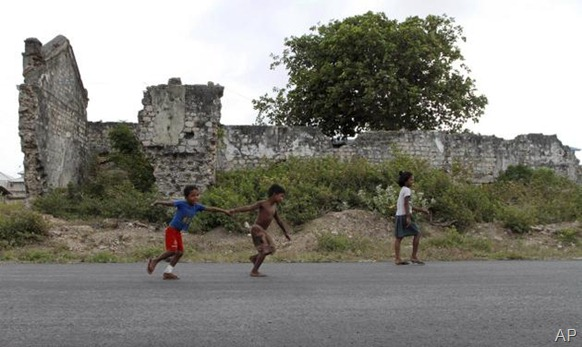 AP In this July 25, 2011 photo, Sri Lankan ethnic Tamil children play in front of a war damaged building in Jaffna, Sri Lanka. For the ethnic Tamils living in the former war zone in the north, it is still a saga of haunted memories, military occupation and missing loved ones.