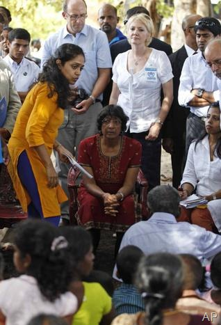 AP - U.N. High Commissioner for Human Rights Navi Pillay listens to ethnic Tamil war survivors during her visit to Mullivaikkal, Sri Lanka, on Tuesday.